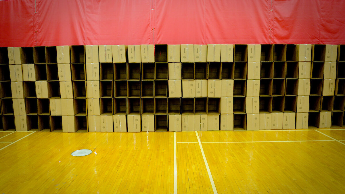 Empty boxes to be filled are arranged along a wall to spell 'NCSU!'